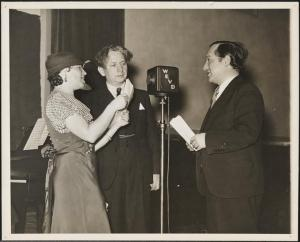 Vera Rozanko and two men at WEVD radio station
